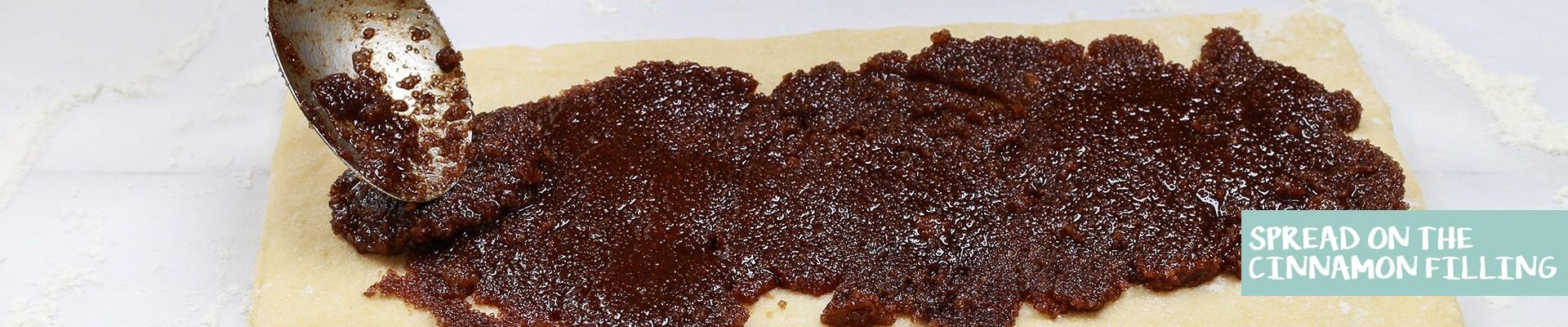spread on the cinnamon filling