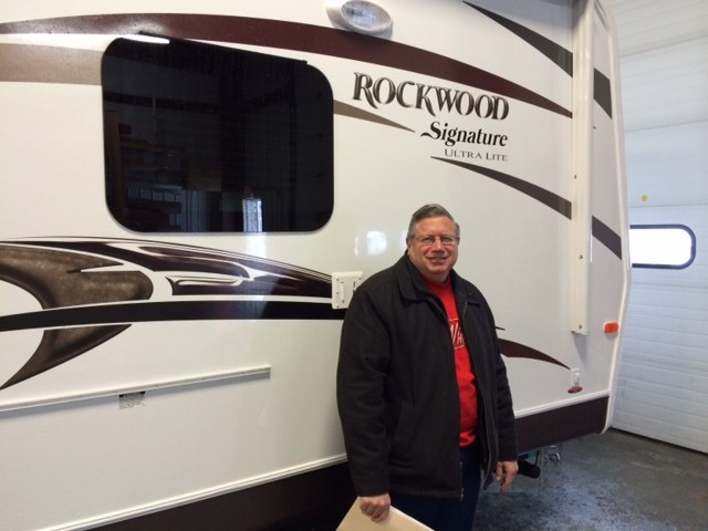 Doug Wyer of Milford with their Rockwood Signature Ultra Lite 8265WS