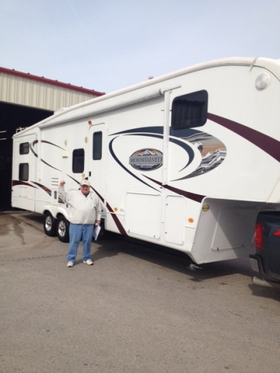Ryan Wolf at All Seasons RV with their Montana Mountaineer 285FBS