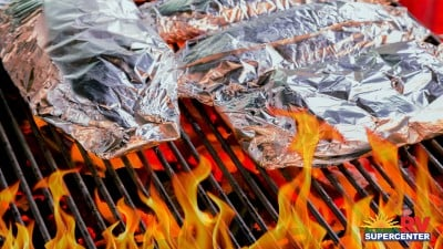 Foil Wrapped Food On Grill