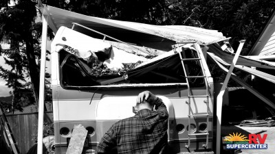 Frustrated Man Standing Infront Of Damaged RV