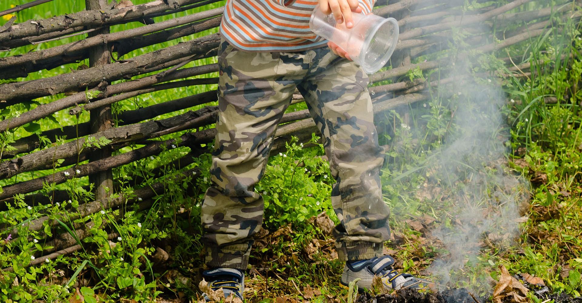 little boy putting out fire