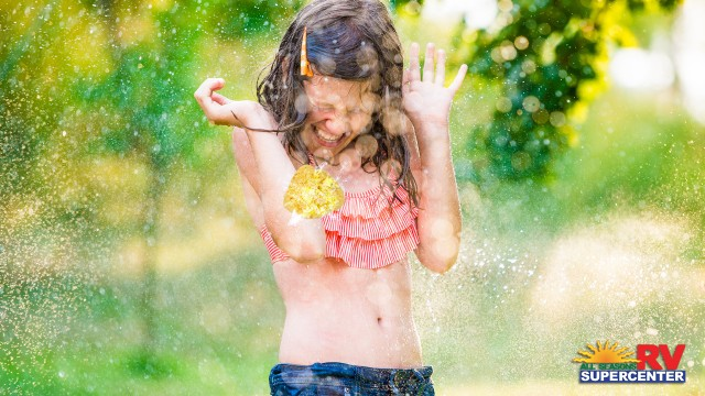 Little Girl Getting Hit By A Wet Sponge On A Hot Summer Day Large