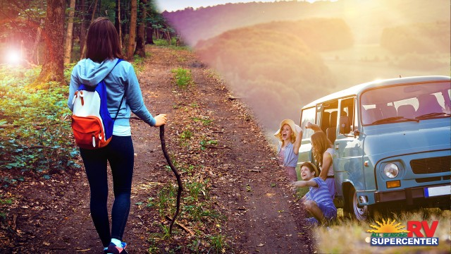 Girl Hiking In The Woods And A Group Of Happy Millennials Outside Van