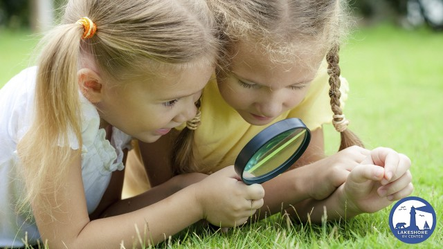 Girls Looking Through Magnify Glass
