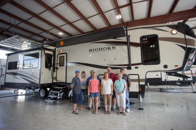 Happy customers at Lakeshore RV with their Bighorn 3760EL