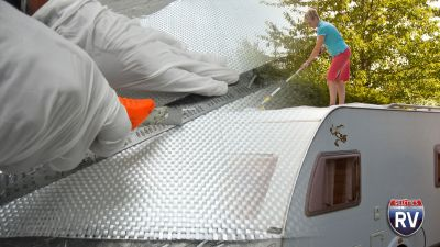 fiberglass-cutting-woman-cleaning-rv-roof