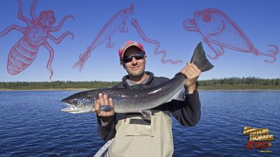 fisherman-holding-large-salmon-with-live-bait-and-lures-in-background-001